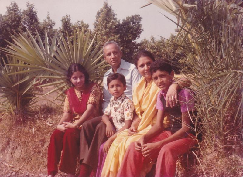 With husband and children back in 1982